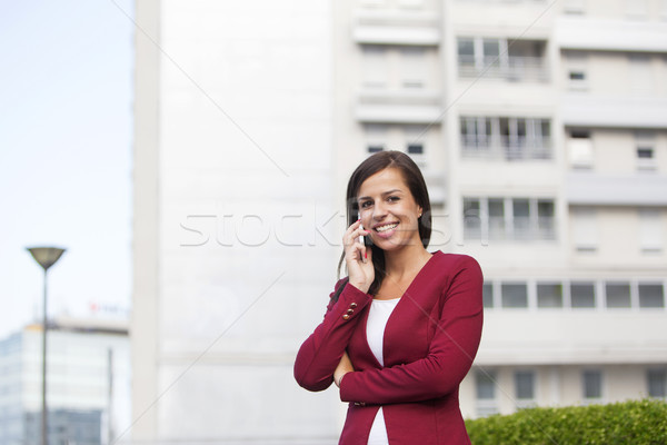 小さな 女性実業家 赤 ブレザー 話し 携帯電話 ストックフォト © boggy