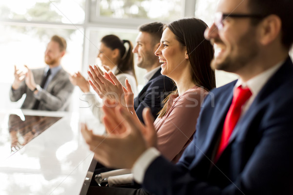 Happy group of businesspeople clapping in office Stock photo © boggy