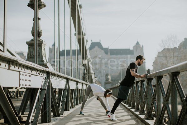 Young couple have training in urban enviroment Stock photo © boggy