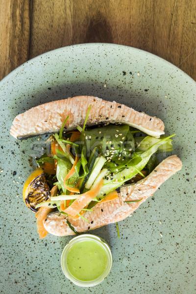 Felső kilátás párolt lazac zöldség tányér Stock fotó © boggy