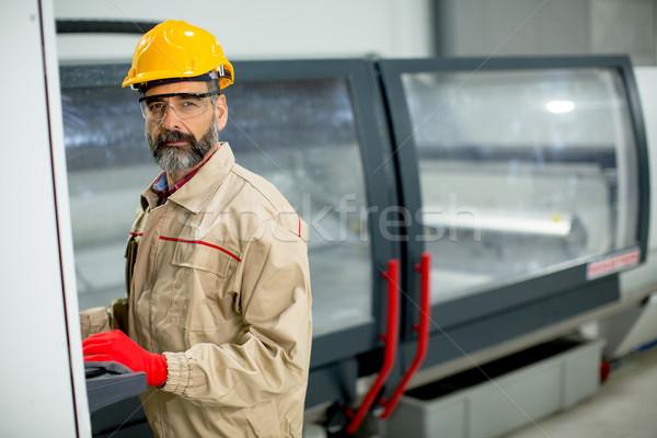 Bonito homem maduro trabalhando mobiliário fábrica moderno Foto stock © boggy