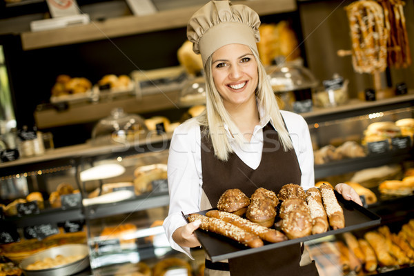 Beautiful female bakery posing with various types of pastries an Stock photo © boggy