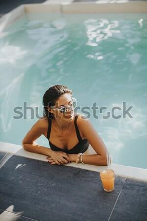 Młodych szczupły kobieta relaks basen hot Zdjęcia stock © boggy