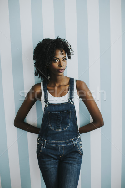 Bastante mujer posando jeans pantalones Foto stock © boggy