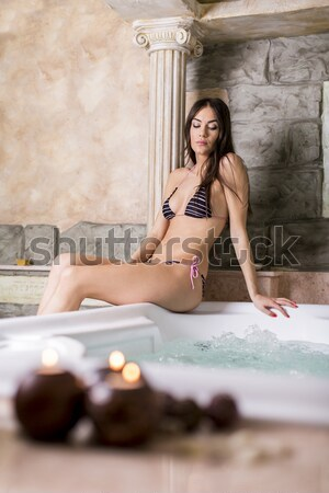 Pretty young woman relaxing in the bubble bath pool Stock photo © boggy