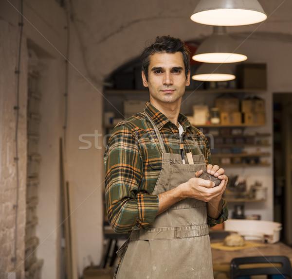 Jóképű fiatalember cserépedények műhely tart agyag Stock fotó © boggy