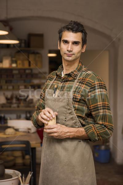 Jóképű fiatalember pózol cserépedények műhely portré Stock fotó © boggy