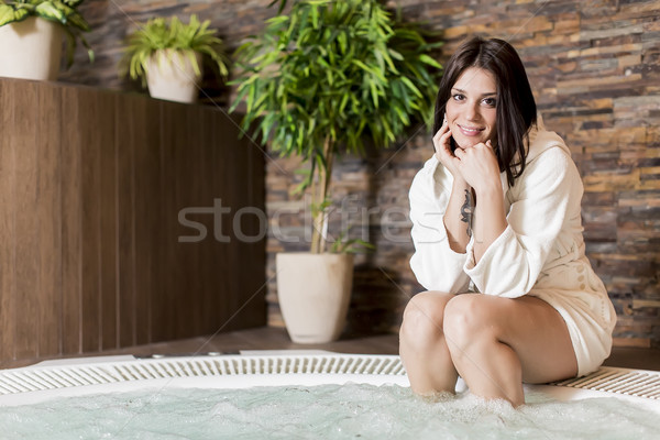 Young woman relaxing in the hot tub Stock photo © boggy
