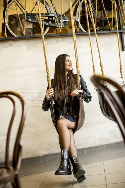 Kadın salıncak güzel genç kadın oturma teknoloji Stok fotoğraf © boggy