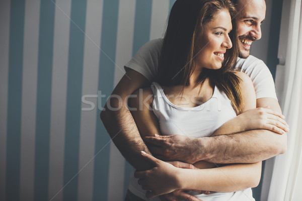 Stock photo: Loving couple by the window