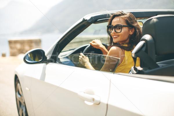 Dość młoda kobieta biały kabriolet samochodu okulary Zdjęcia stock © boggy