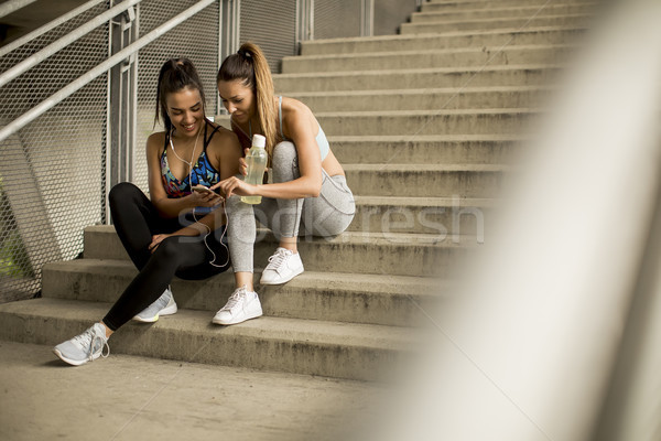 Young females runner resting on stairs Stock photo © boggy