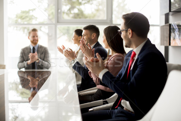 Businesspeople applauding while in a meeting at office Stock photo © boggy