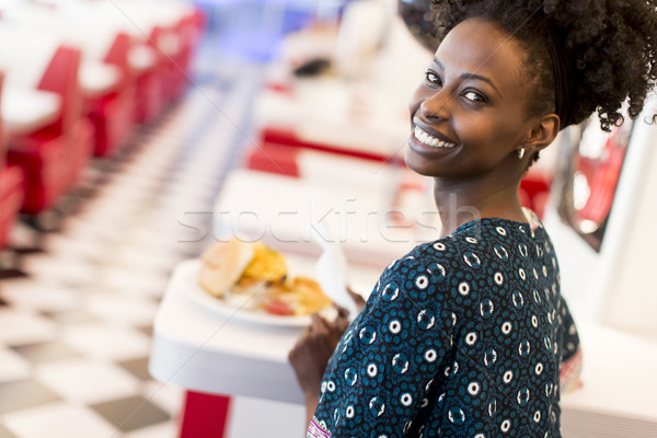 African american woman in diner Stock photo © boggy