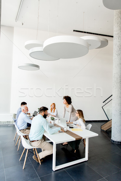 Business people around table during staff meeting Stock photo © boggy