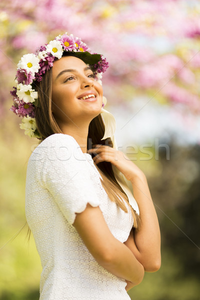 Young woman with flowers in her hair on sunny spring day Stock photo © boggy