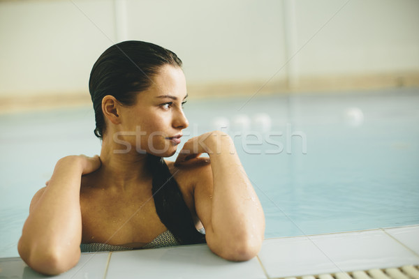 Young woman by the swimming pool in the spa center Stock photo © boggy