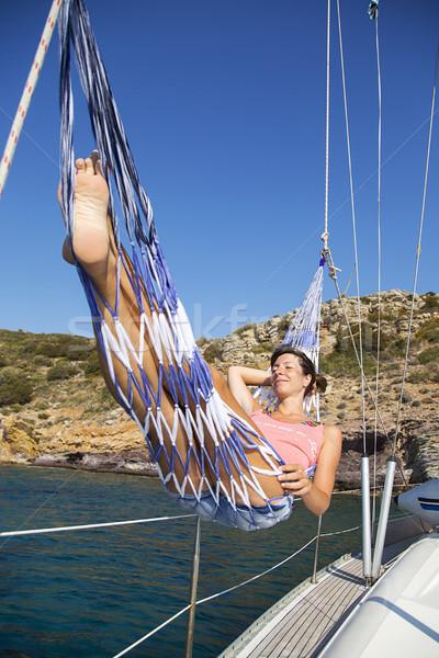 Mujer hamaca velero viaje vacaciones vacaciones Foto stock © boggy