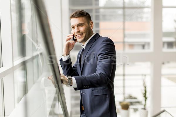 ストックフォト: ハンサム · ビジネスマン · スーツ · 話し · 携帯電話