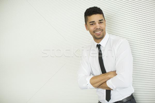 Genç siyah adam gri duvar yakışıklı ayakta Stok fotoğraf © boggy