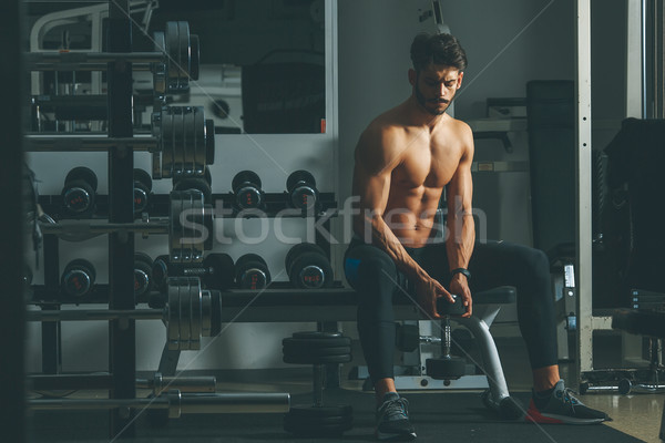 Young man training in the gym Stock photo © boggy