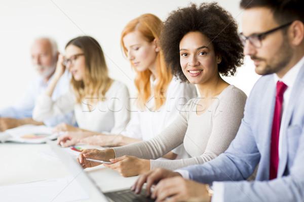 Alegre equipe de negócios trabalhar moderno escritório ver Foto stock © boggy