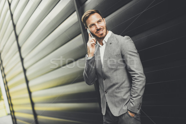 Successful businessmen entrepreneur using mobile phone outdoor Stock photo © boggy