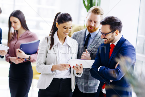 Businesspeople standing in the modern office Stock photo © boggy