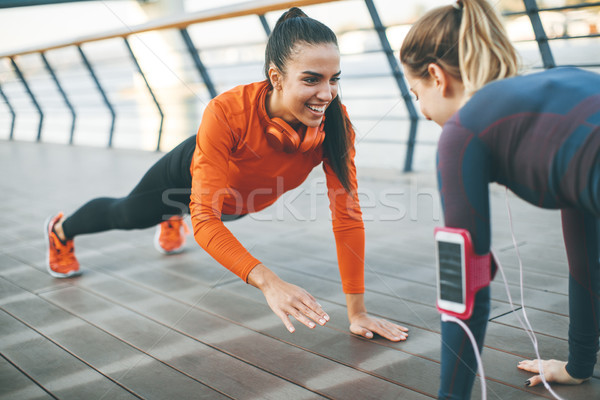 Women doing plank on riverside Stock photo © boggy