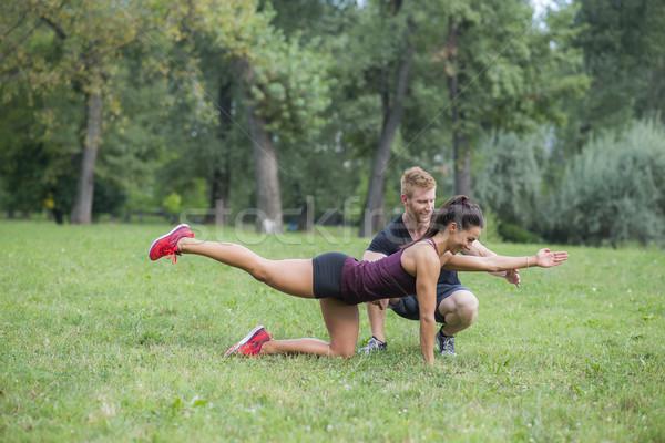 Genç kadın antreman personal trainer park kadın adam Stok fotoğraf © boggy
