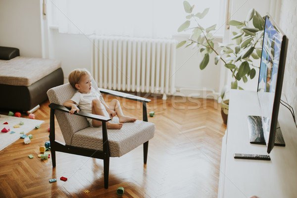 Little boy sitting on armchair and watching television Stock photo © boggy