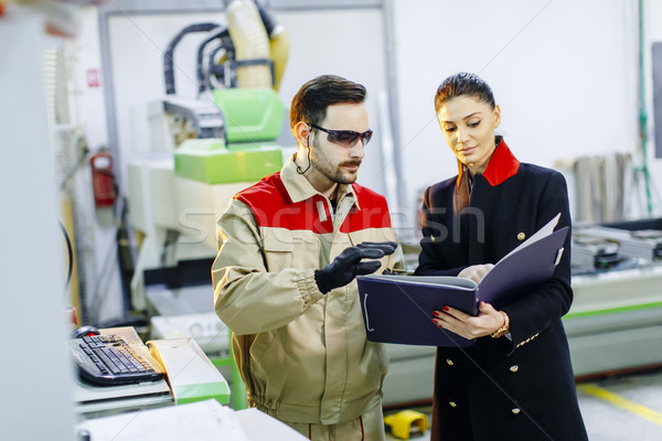 Pretty young woman controlling process in the factory Stock photo © boggy