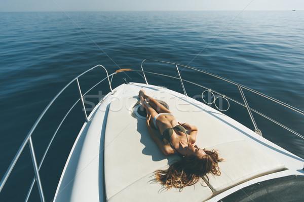 Jovem mulher atraente luxo iate flutuante mar Foto stock © boggy