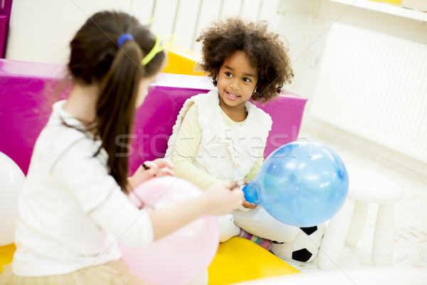 Cute little girl with a balloon Stock photo © boggy