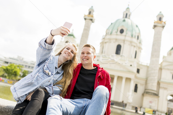 Dating young couple happy in love taking selfie self-portrait ph Stock photo © boggy