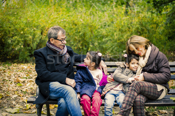 Grandparents and granddaughters in autumn park Stock photo © boggy