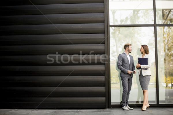 молодые деловые люди говорить документы Открытый бизнеса Сток-фото © boggy
