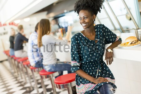 Young black woman in the diner Stock photo © boggy