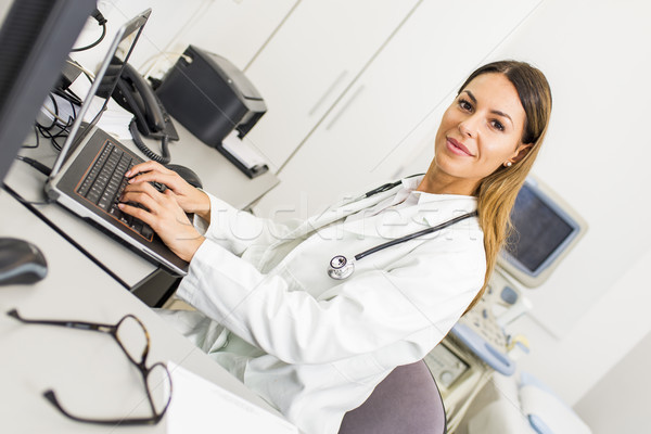 Young female doctor working on computer Stock photo © boggy