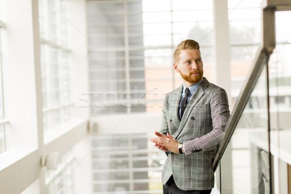 молодые бизнесмен вверх лестницы офисное здание бизнеса Сток-фото © boggy