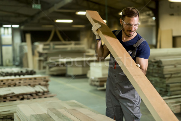 Young man in a furniture factory Stock photo © boggy