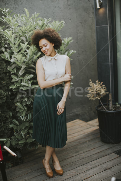 Pretty young african descent woman in the yard Stock photo © boggy