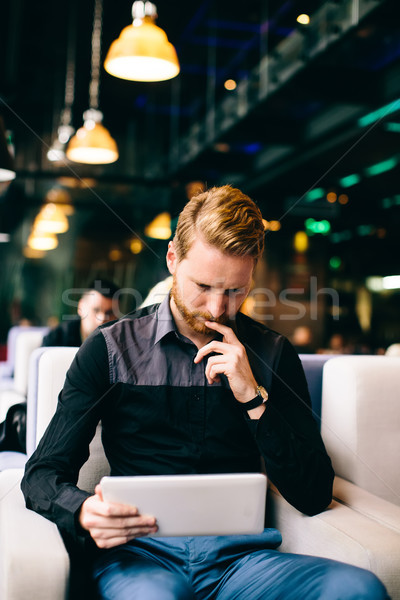 Redhair man with tablet Stock photo © boggy