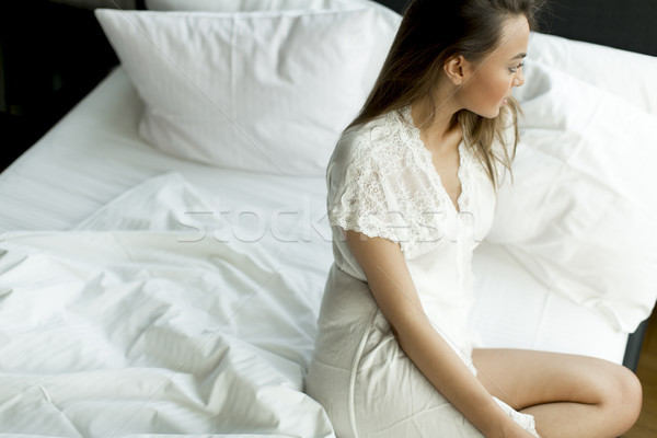 Young woman on the bed Stock photo © boggy