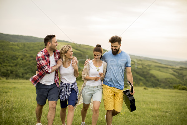 Group od young people having fun on a trip in nature Stock photo © boggy
