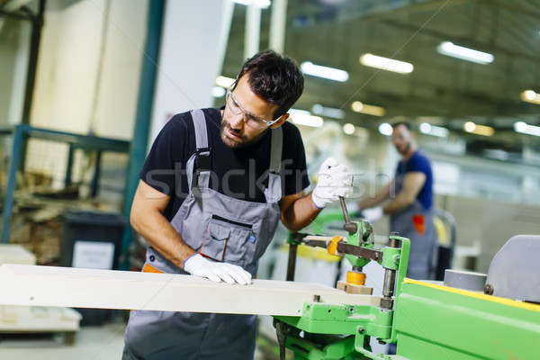 Two handsome young men working in furniture factory Stock photo © boggy
