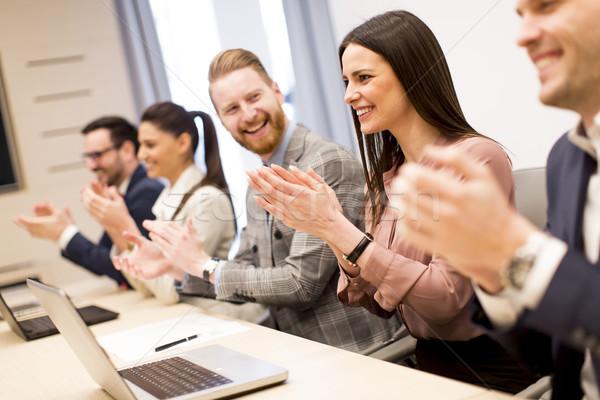 Fiatal üzletemberek tapsol kezek iroda nő Stock fotó © boggy