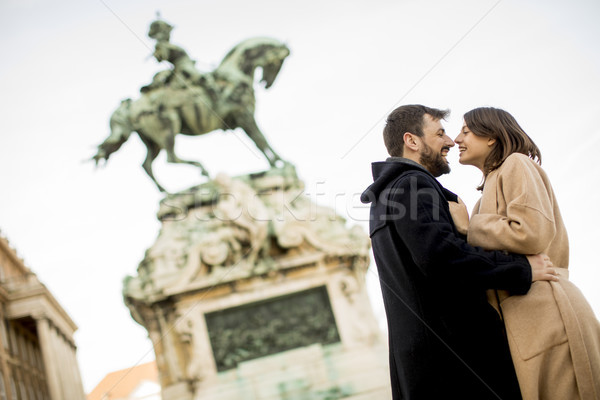 Loving couple outdoor with monument in background in Budapest Stock photo © boggy