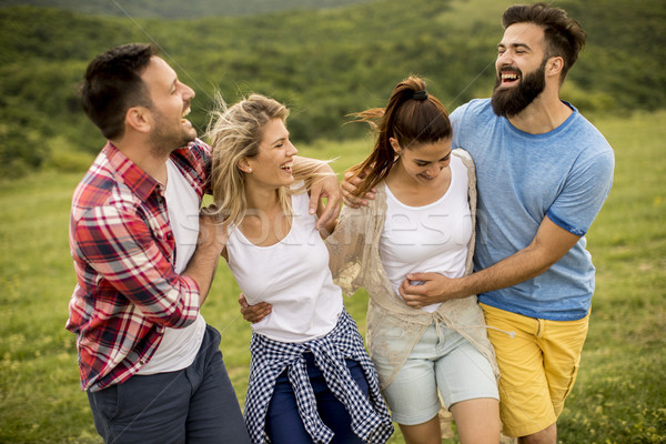 Stock photo: Group od young people having fun on a trip in nature