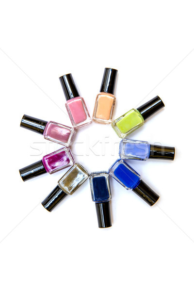 Coloured nail polish bottles stacked circle on a white backgroun Stock photo © boggy